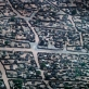 An aerial view taken of the camps for internally displaced people and refugees from Darfur. Kate Holt.