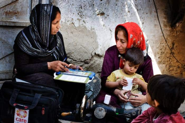 Alia Walezada a CBE (Community Based Educator) talks to Farida, a 32 year old mother of seven children. Kate Holt.