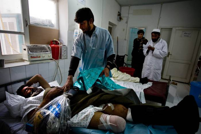 Abdullah, a shepherd, lies in the Emergency Room at the Bost Hospital. Kate Holt.