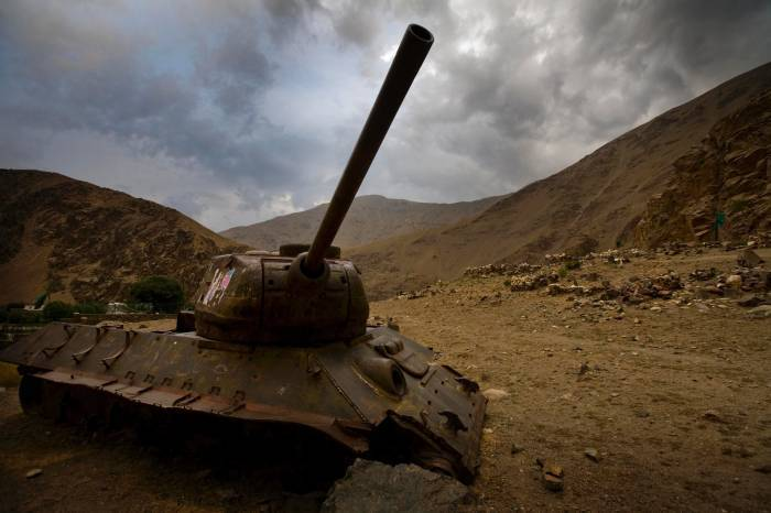 A rusting Russian tank sits ominously under a cloudy sky along the road up the Panjshir Valley. Kate Holt.
