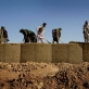 Locally employed workmen help to build an administrative base that is being secured by 2-508 of the 82nd Airborne Division. Kate Holt.
