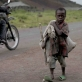A young boy flees from renewed fighting in Kibati, five kilometers north of the provincial capital of Goma. Kate Holt.