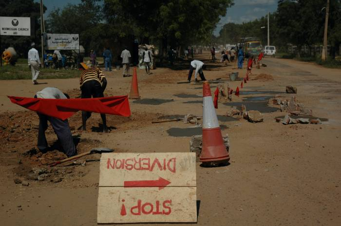 Men work on the construction of a new road in Juba, Southern Sudan. Kate Holt.