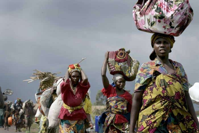 Women flee from renewed fighting near Kibati, five kilometers north of the provincial capital of Goma. Kate Holt.