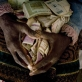Masiziba Saiba is sits in her room with her life savings of Zimbabwean dollars that are now worthless. Kate Holt.