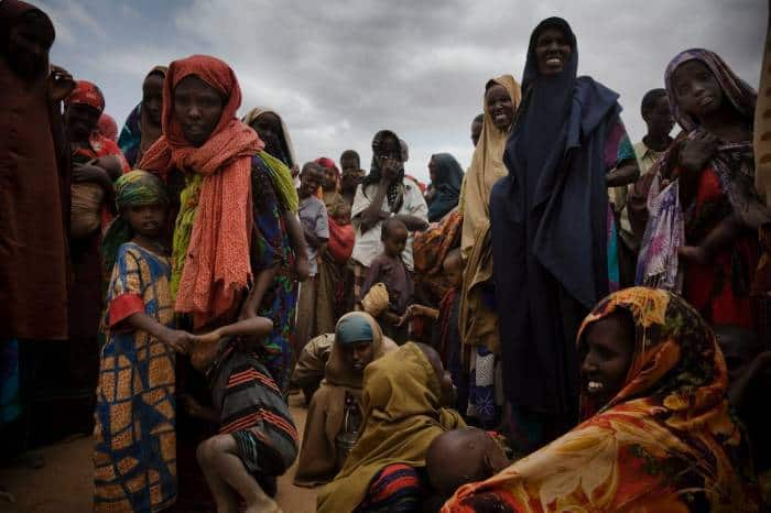 Newly arrived refugees from Somalia wait to be registered and receive food aid in Dadaab Refugee Camp. Kate Holt.