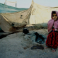A young girl in a makeshift shelter in one of the many overcrowded refugee camps along Afghanistan's border. Kate Holt.