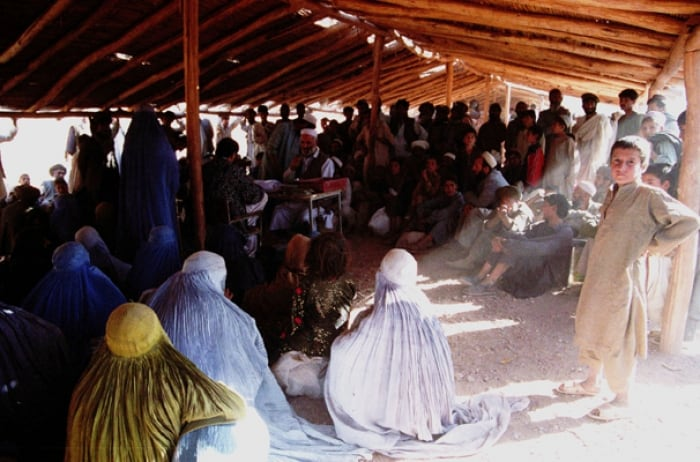 A food distribution point within a refugee camp on the Afghanistan border. Kate Holt.