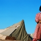 A girl in front of tents in a refugee camp for Afghans in Pakistan. Kate Holt.