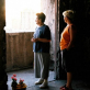 Two women return to what remains of their apartment building ten years since the war ended in Bosnia. Kate Holt.