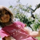 A young girl in the village of Dobraje, Kosova. The village has around 150 families. Kate Holt.