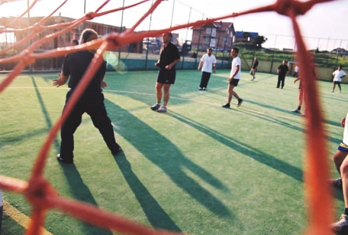 Care Kosova Staff take part in a weekly football match in Pristina. Kate Holt.