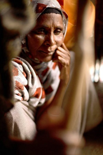 A woman whose family have lost nearly all their cattle and who are now dependent on food aid. Kate Holt.