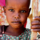 A young girl who lives in a community that is dependent on food aid supplied by Care. Kate Holt.