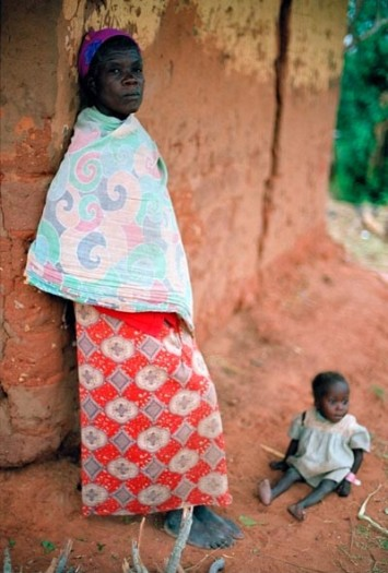 A widow with her young child in a village that has been repeatedly attacked by different armies. Kate Holt.