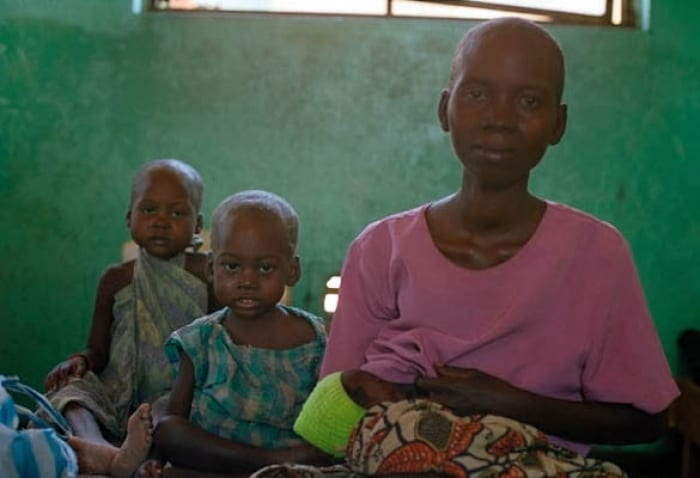 A mother and her children in Nyunzu hospital who fled her village following a series of brutal attacks. Kate Holt.