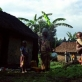 A family stand outside their homes in a small village north of Goma. Kate Holt.