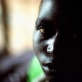 Portrait of a young girl in a female ward of Bukavu Hospital. Kate Holt.