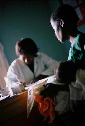 A woman, who is HIV positive sits in a consultation with a doctor from MSF, in Bagera clinic. Kate Holt.