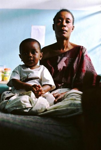 Atusha and her son sit in Bagera Hospital, Bukavu. She is HIV positive. Kate Holt.