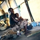 A young mother with her daughter in a tent they share with ten other families in the IDP camp. Kate Holt.
