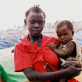A girl and her baby in the IDP camp in Bunia. Kate Holt.