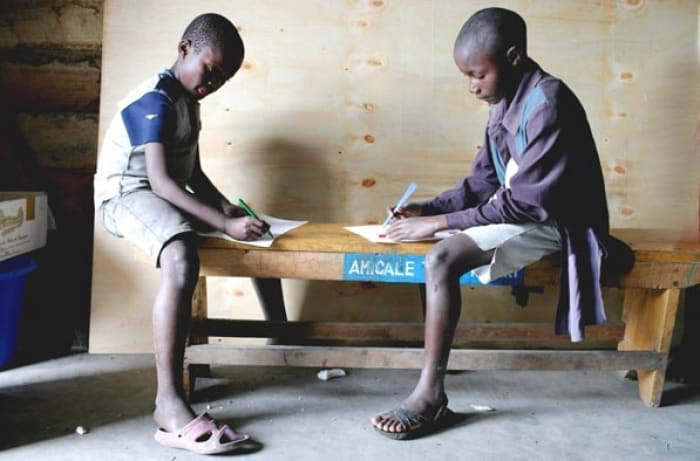 Boys from the Street Children project prepare their entry for the competition. Kate Holt.