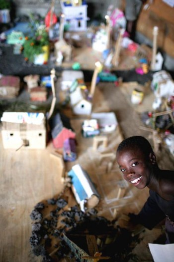 A young boy from the Street Children project shows off his group's entry. Kate Holt.