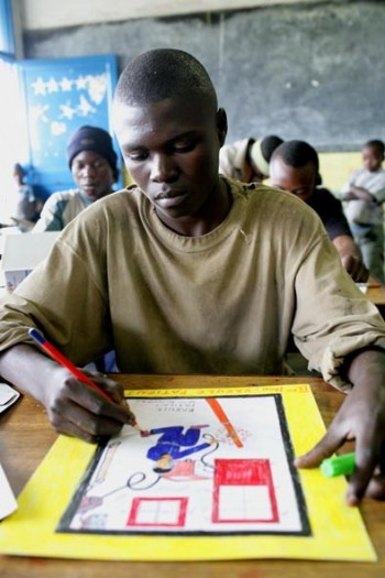 An older boy from Don Bosco prepares his entry drawing. Kate Holt.