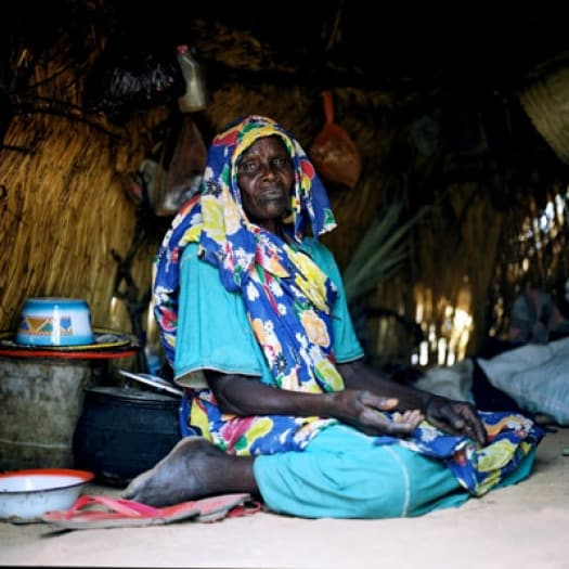 A widow in Krindig Camp, Darfur. HelpAge are trying to ensure that elderly people are receiving the assistance. Kate Holt.