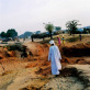 The main road through Krindig Camp, Darfur, where Helpage are working. Kate Holt.