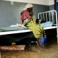 In Kagenyi Healthcare Centre an elderly woman looks after her sick grandson. Kate Holt.