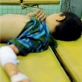 Two young boys lie side by side after being admitted to Nazariyah hospital. Kate Holt.
