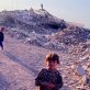 Children play in the ruins of the Baath Party headquarters in Nazariyah. Kate Holt.