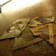 The shattered remains of Saddam Hussein's picture litters the floor of a hospital in Baghdad. Kate Holt.
