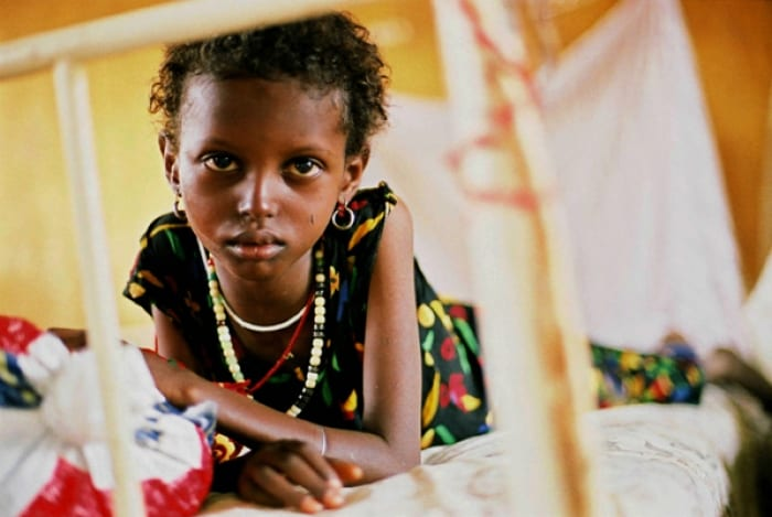 A young girls who suffers from TB in an infectious disease hospital that is supported by Johanniter. Kate Holt.