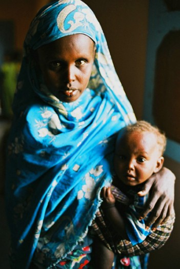An Afar woman and her baby at a health post near Tadjoura, Djiobuti, that is supported by Johanniter. Kate Holt.