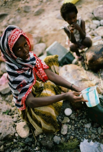 A young Afar girl at a water collection point that has been rehabilitated by Johanniter. Kate Holt.