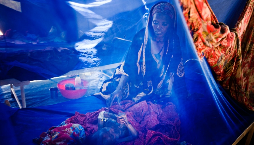 A mother watches her child in the emergency medical centre in the Burundi Contingent Headquarters. Kate Holt.