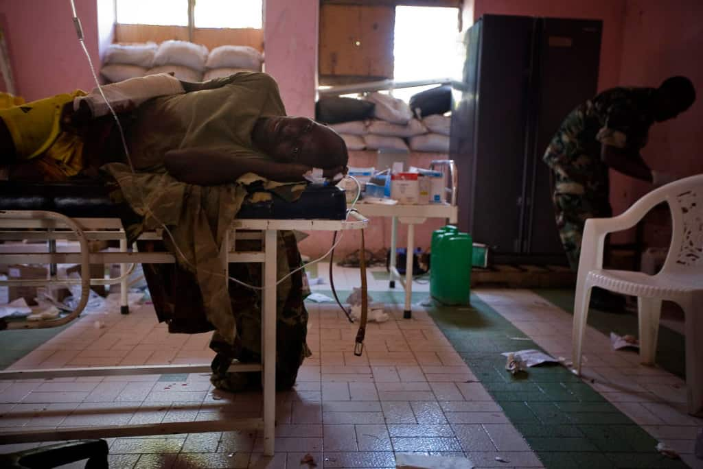 Soldiers from Burundi working for AMISOM,  provide fire support from a rooftop position at the old Military Academy. Kate Holt.
