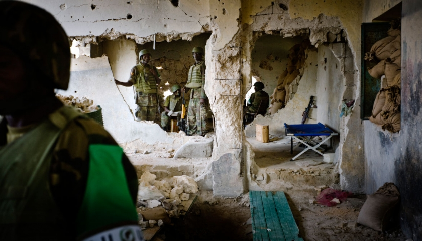 AU soldiers man their positions in a house they have just taken from the control of Al Shabaab insurgents in the Sigaale District of Mogadishu. Kate Holt.