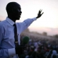 An evangelical Preacher speaks to a crowd of thousands of people in Juba town at sunset. Kate Holt.