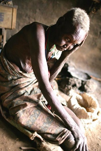 An elderly woman with what little food she has left for the month in Luri Rokwe Leper Colony. Kate Holt.