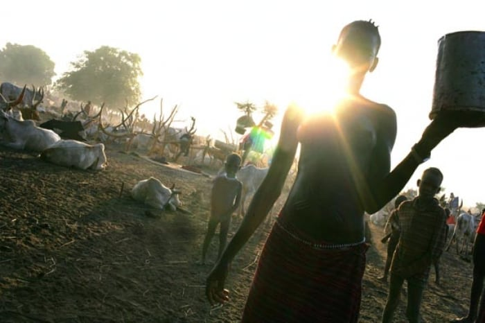 A woman with her young family in a cattle camp, South Sudan. Kate Holt.