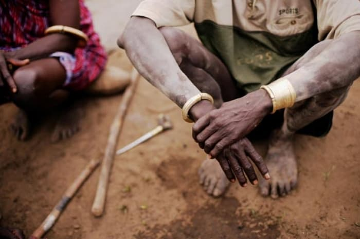Jewellery worn by Mundari tribesman was traditionally made from ivory and bones. Kate Holt.