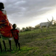 A widow and her two children watch rain approaching over their cattle camp near Juba; Southern Sudan. Kate Holt.