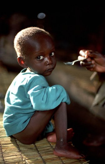 A young boy receives supplementary feeding three times a week at an IRC feeding centre in South Kivu. Kate Holt.