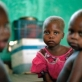 Three young children in a hospital supported by the IRC in Kalemie, Katanga. Kate Holt.
