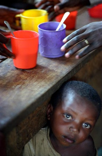 A young boy at a supplementary feeding centre run by the IRC. Kate Holt.