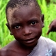"A young boy who is a beneficiary of the IRC""s water projects in Kalemie, Katanga. Kate Holt."